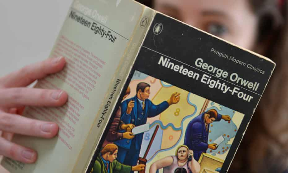 Woman holding George Orwell's Nineteen Eighty-Four
