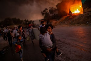 Migrants and refugees fleeing Moria camp after fire broke out. Island of Lesbos, September 9, 2020