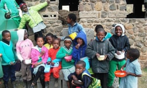 Pupils at Semonkong African Methodist episcopal primary school in Lesotho eat a lunch provided by the World Food Programme