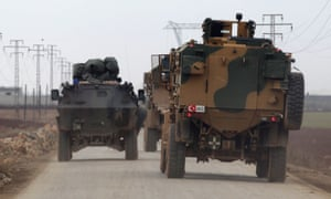 Turkish military vehicles heading towards the northern Syrian town of al-Bab.