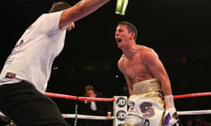 Anthony Crolla celebrates with trainer Joe Gallagher.