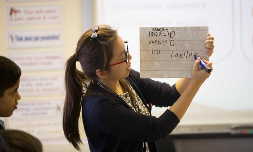 Li Chen, from Shanghai, teaches maths to pupils in London