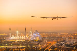 Solar Impulse 2 flies over the Sheikh Zayed Grand Mosque in Abu Dhabi as it prepares for take off for the first leg of its journey