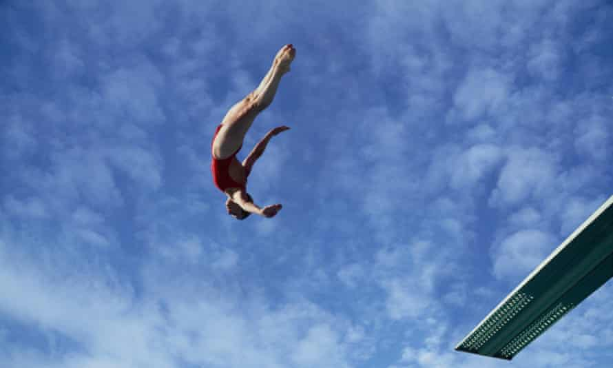 woman diving off diving board