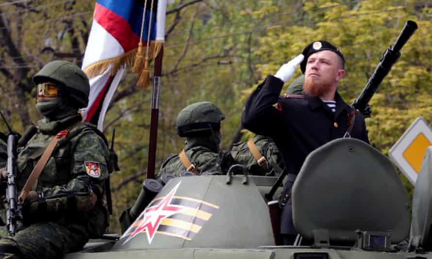 Arseny Pavlov, known as 'Motorola', saluting while taking part in a military parade.