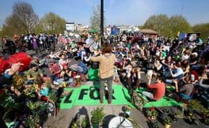Demonstrators hold a meeting on Waterloo Bridge
