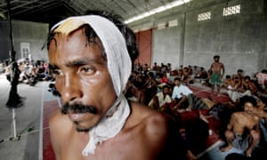 A rescued migrant now at the new confinement in Langsa, Indonesia on Friday. More than 750 Rohingya and Bangladeshi migrants were rescued off Indonesia, plus another 200 off the Indonesian island of Aceh.
