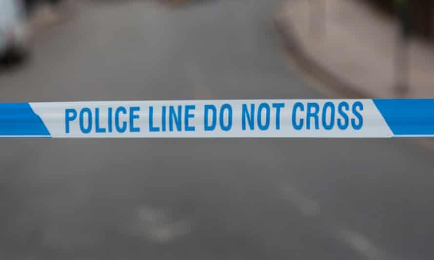 Police cordon tape. Police line do not cross.
