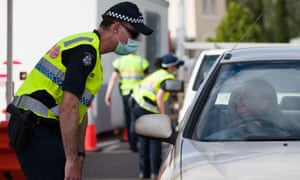 Police check permits at the Victorian border on 1 January 2021.
