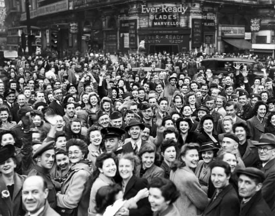 Crowds gather in Piccadilly Circus on the eve of VE Day.