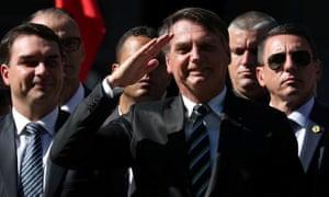 Jair Bolsonaro salutes