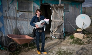 Romanian farm worker Nicoleta Bolos and her baby daughter in front of their home in Ragusa province, Sicily