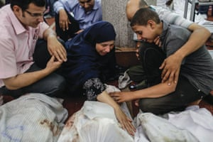 A woman with the body of her son, a Morsi supporter who was killed as security forces broke up a gathering at Rabaa al-Adawiya, Cairo, Egypt, on 15 August 2013.