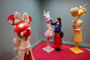 Urayasu, JapanA staff member cleans an artwork with disinfectant in the new 'Minnie's Style Studio' at Tokyo Disneyland. Tokyo Disneyland unveiled to the media the new 'Beauty and the Beast' area with special arrangements to prevent the spread of the coronavirus
