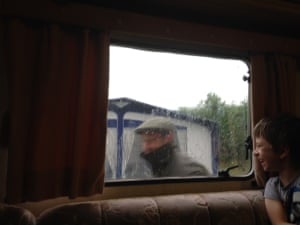 "<strong>Performing the 'Descending Invisible Steps' trick in the rain</strong><br>""Driven to desperate entertainment measures by the incessant rain, John stands outside the caravan window to give a masterly demonstration of the Magic Invisible Steps.""<br><br>I bet the hours are flying by.<br><br>Photograph: <a href=""https://witness.theguardian.com/assignment/55b6038de4b0a4260de253c7/1638191"">Ann Baylis</a><a>/GuardianWitness</a>"