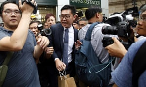Andy Chan is surrounded by photographers in Hong Kong