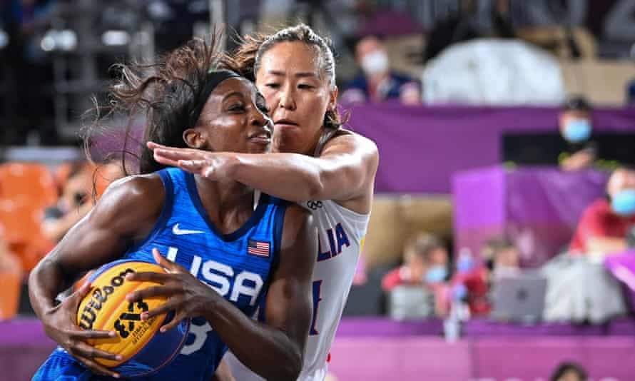 USA player Jacquelyn Young shields the ball from Mongolia's Solongo Bayasgalan.