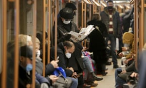 Passengers wearing facemasks on a subway train in Moscow, Russia