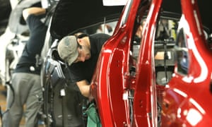 Employees work on the production line at Nissan's Sunderland factory