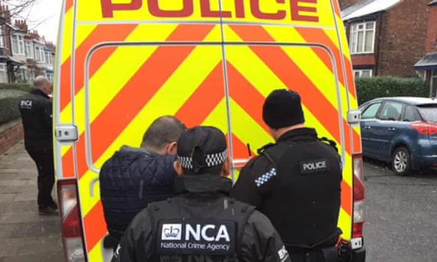 Officers from the National Crime Agency take part in raids across the UK as part of an investigation into people smuggling.