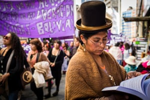 A cholita reads a book next to a newsstand during the march for International Women's Day in La Paz. Even if in the last decade women, and especially indigenous women, have made enormous progresses in Bolivia, they are still very far from being equal to their male counterparts. Issues like domestic violence and access to education are still major problems that need to be faced by the Government and society in general