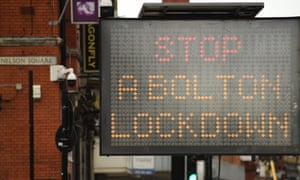An electronic board urges people to observe coronavirus guidance in Bolton, where local lockdown restrictions are in place.