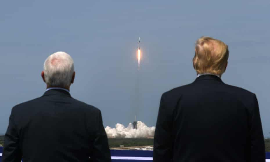Donald Trump and Vice-President Mike Pence watch the launch of a SpaceX Falcon 9 rocket and Crew Dragon spacecraft at Cape Canaveral, Florida.