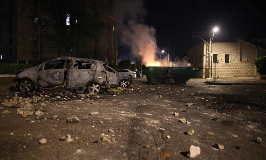 Burnt cars and a skip in the city of Lod during clashes between Israeli far-right extremists and Arab-Israelis.