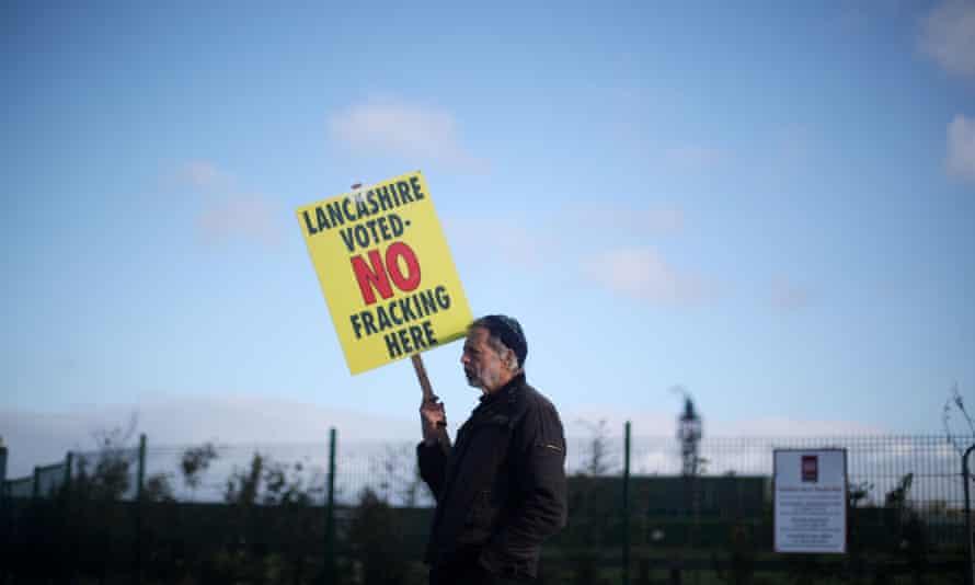 A protester stands outside Cuadrilla's Preston Road fracking site near Blackpool.