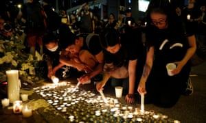 Protesters light candles in Hong Kong in honour of a man who died after falling from a scaffolding