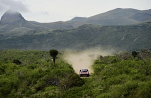 Peugeot's Sebastien Loeb and co-pilot Daniel Elena kick up dust