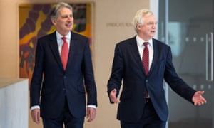 Philip Hammond and David Davis arrive for a meeting with executives from the financial services at the Shard in central London.