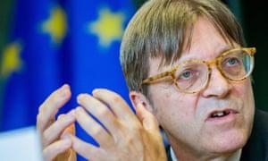 Guy Verhofstadt in front of an EU flag
