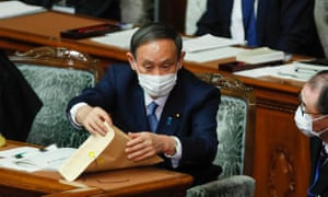 Japanese prime minister Yoshihide Suga prepares for his speech on climate change in parliament on Monday.
