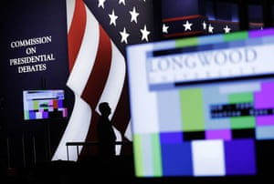 An official stands on stage during preparations for the vice-presidential debate at Longwood University.