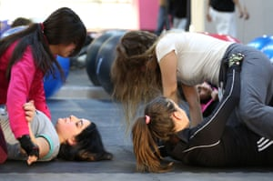 Women train at the SheFighter studio, whose staff plan to offer self-defence classes to women at the Zaatari refugee camp.