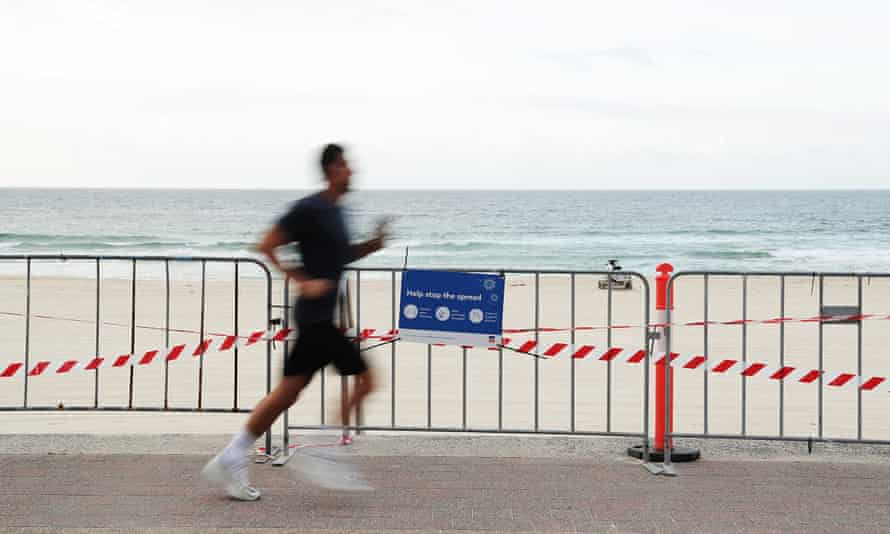 A jogger runs along Bondi Beach in Sydney under the police enforced rules