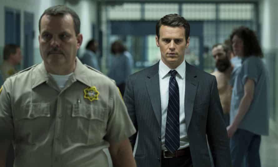 Jonathan Groff (right) plays Holden Ford in Mindhunter.