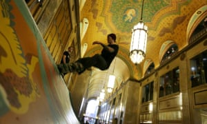 Riding high: skateboarders inside the Fisher Building in Detroit.