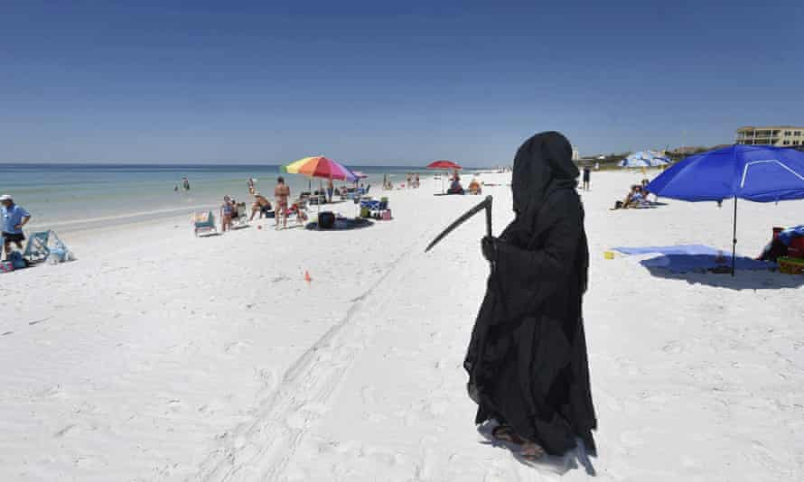 Daniel Uhlfelder, a Florida attorney, dressed as the Grim Reaper at the newly opened beach near Destin, Florida, on 1 May.