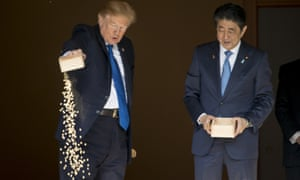 Donald Trump, Shinzo AbePresident Donald Trump pours the remainder of his fish food out as he and Japanese Prime Minister Shinzo Abe feed fish in a koi pond at the Akasaka Palace, Monday, Nov. 6, 2017, in Tokyo. Trump is on a five country trip through Asia traveling to Japan, South Korea, China, Vietnam and the Philippines. (AP Photo/Andrew Harnik)