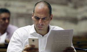 Yanis Varoufakis<br>Parliament member Yanis Varoufakis checks his cell phone before a meeting with lawmakers of Syriza party at the Greek Parliament in Athens, Friday, July 10, 2015. Greece's Prime Minister Alexis Tsipras will seek backing for a harsh new austerity package from his party Friday to keep his country in the euro — less than a week after urging Greeks to reject milder cuts in a referendum. (AP Photo/Thanassis Stavrakis)