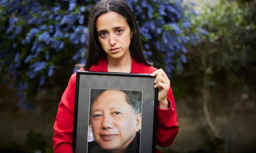 Safiah Ngah holding photo of her father.