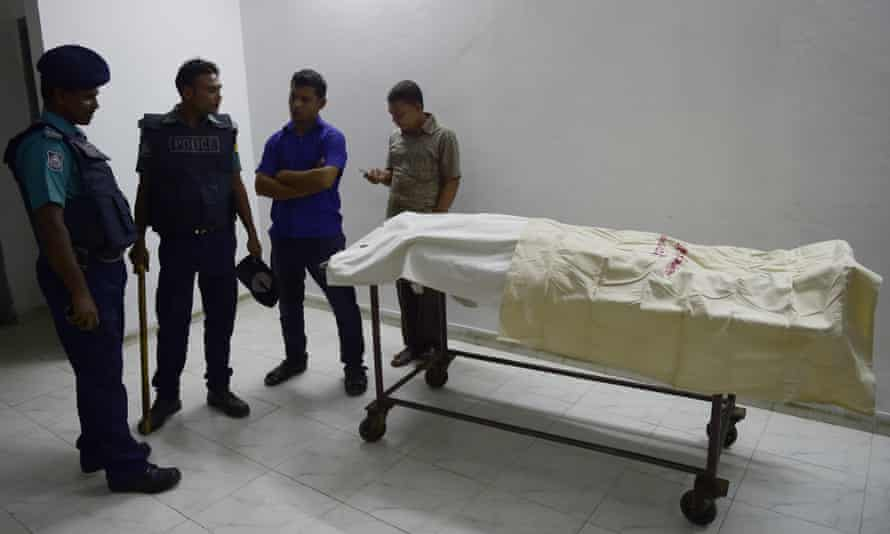 Police standing with the body of Faisal Arefin Deepan