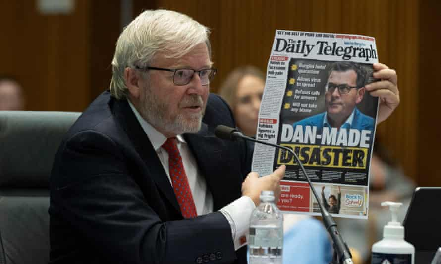 Former prime minister Kevin Rudd holds up a front page of Sydney's Murdoch-owned Daily Telegraph at the media diversity inquiry in Canberra in February.