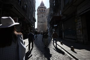 People walk around the Galata Tower during a general curfew imposed on Sundays n Istanbul, Turkey on 28 March, 2021.