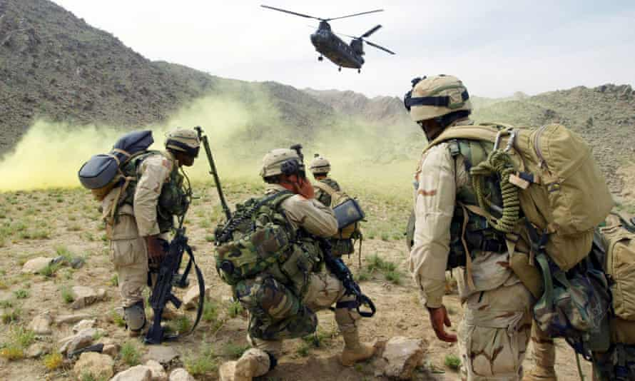US soldiers prepare to board a helicopter north of Kandahar days after Afghanistan signed the Rome statue of the international criminal court in May 2003.