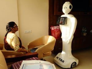 A Covid-19 patient takes instructions from a dietician through a robot at Yatahartha hospital in Noida, Uttar Pradesh, India