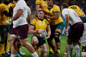 Australia's flanker Jack Dempsey is congratulated after scoring a try.