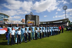 England line up for the national anthems.